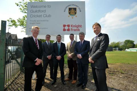 SNAP Sponsorship, Guilford Cricket and Knight Frank Executives stand proudly with the new entrance sign at Guildford Cricket Club